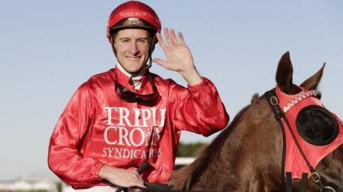Blake Shinn all smiles after another win on a Triple Crown racehorse