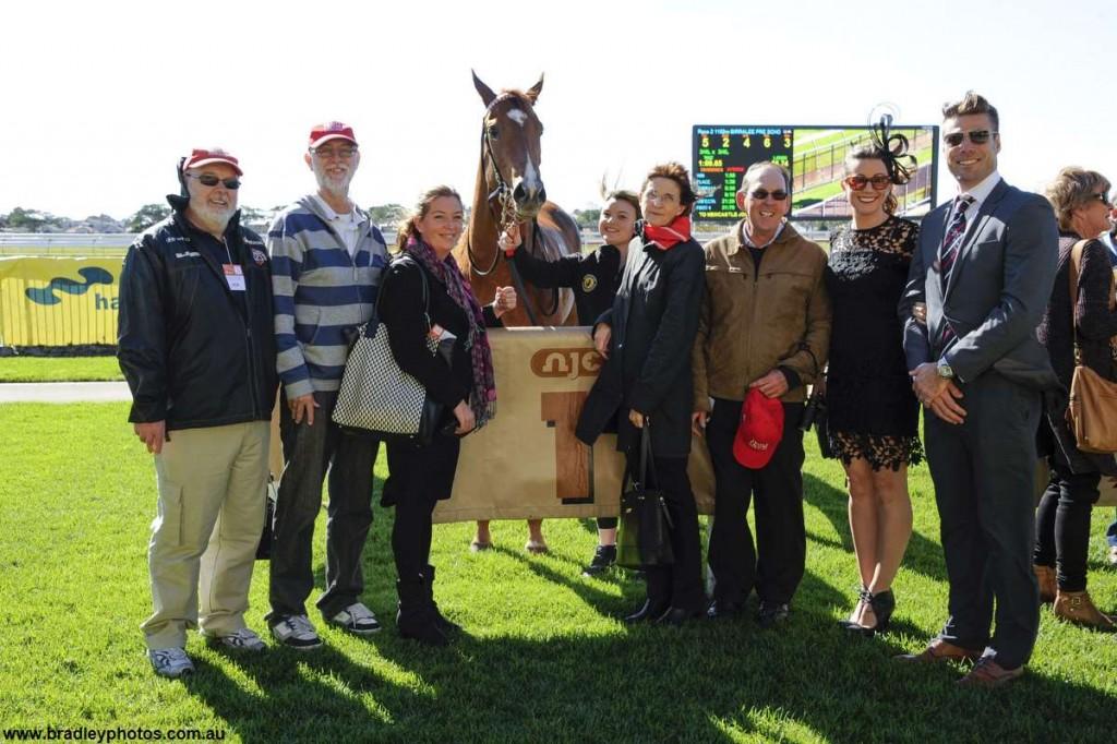Triple Crown Syndications' Bukzel owners winning photo
